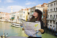 woman looking at a map in venice