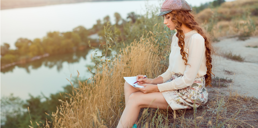 woman journaling on the beach