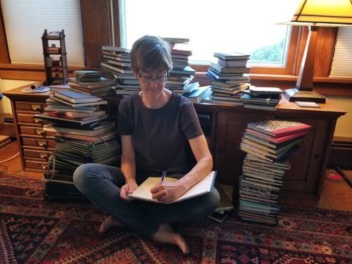 Paula-vene-smith-surrounded-by-her-journals